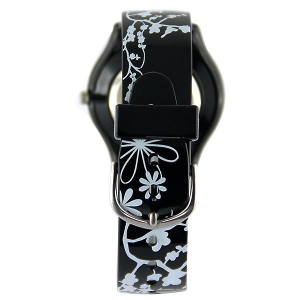 montre femme pas ch re fleur blanche bracelet noir. Black Bedroom Furniture Sets. Home Design Ideas